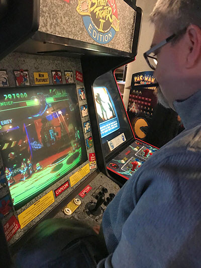Todd Hannigan playing an arcade game