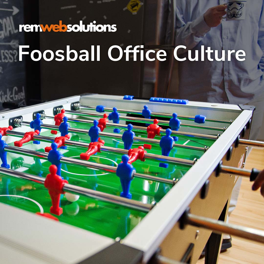 Todd playing foosball in the office